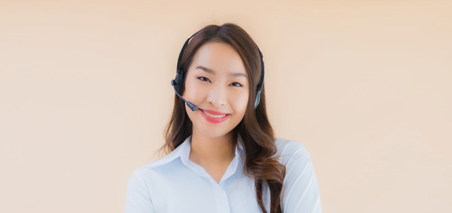 Portrait young Asian business woman with headphone customer care support